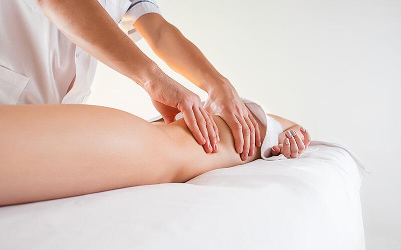 upper leg being massaged